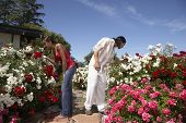 Multi-ethnic couple smelling flowers