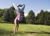 African American woman doing handstand