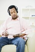 African American man listening to headphones