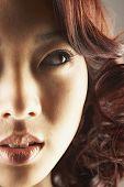 Asian woman looking sideways