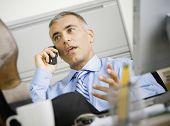 Middle Eastern businessman talking on telephone