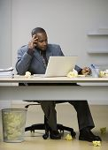 African American businessman looking at laptop