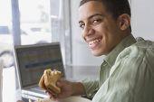 Mixed Race boy eating sandwich