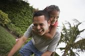 Hispanic father and daughter playing