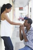 African American man kissing girlfriend's hand