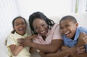 African American mother and children laughing