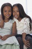 African American sisters hugging