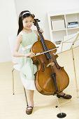 Asian girl playing cello