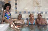 Group of seniors in hot tub
