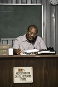 Senior African American male worker talking on telephone