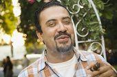 Hispanic man smoking cigar