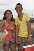 Teenaged Hispanic couple holding hands