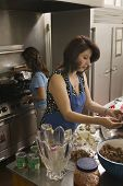 Hispanic women preparing food
