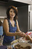 Hispanic woman preparing food