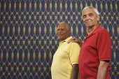 Senior man with hand on friend's shoulder