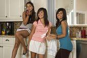 Hispanic teenaged girls in kitchen