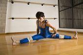 stock photo of do splits  - Hispanic male dancer doing split - JPG