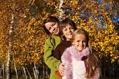 Walk in the park - family autumn portrait