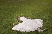 African woman laying in grass