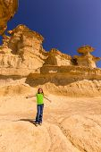 Bolnuevo Mazarron eroded sandstones in Murcia spain with open arms blond girl