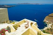 Patio with a view of the caldera illustrating the lifestyle  on the Greek island of Santorini in the Aegean