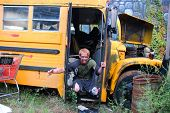 MUSKOGEE, OK - Sept. 13: Bloodied zombie comes out from a school bus during the Castle Zombie Run at the Castle of Muskogee in Muskogee, OK on September 13, 2014.