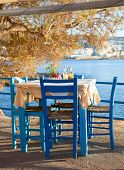 Typical table with chairs of outdoor greek cafe