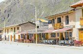 OLLANTAYTAMBO, PERU, MAY 4, 2014 -  restaurants and hostels in main square (Plaza de Armas)