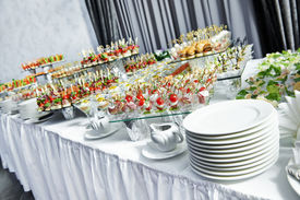 stock photo of buffet catering  - catering services background with snacks on guests table in restaurant at event party - JPG