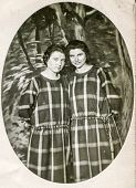 BERLIN, GERMANY, CIRCA 1930's: Vintage photo of two women in plaid dresses