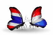 Two Butterflies With Flags On Wings As Symbol Of Relations Thailand And Luxembourg