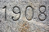 Granite Background With 1908 Year