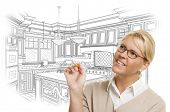 Creative Woman With Pencil Over Custom Kitchen Design Drawing on White.