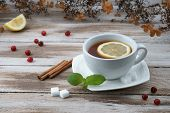 Cup of tea with cranberry and lemon piece