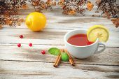 Cup of tea with cranberry and lemon