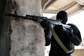 picture of extremist  - Soldier targeting with a rifle from the hideout - JPG