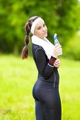 Happy Sexy Caucasian Fit Woman Jogging Outdoors And Drinking Water.