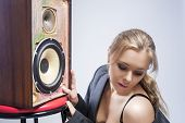 Portrait Of Sexy And Seductive Young Caucasian Woman Listening To Loud Speaker