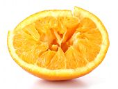 Squeezed orange isolated on white