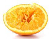 Squeezed orange isolated on white