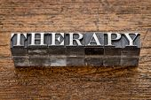therapy word in mixed vintage metal type printing blocks over grunge wood