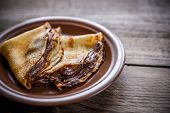 pic of crepes  - Crepes With Chocolate Cream On The Wooden Table - JPG