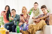 Young People At House Party Toast
