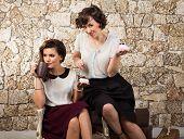 Two Beautiful Girl Friends Having A Tea