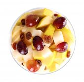 Healthy breakfast - yogurt with  fresh grape and apple slices and muesli served in glass bowl, isolated on white