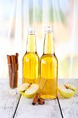 stock photo of cider apples  - still life with apple cider and fresh apples on wooden table - JPG