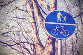 Retro Filtered Pedestrians And Cyclists Only Sign In A Park.