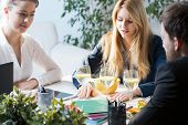 pic of assemblage  - Three young busy people on business lunch - JPG