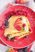 crepe with sugar and berry