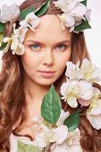 Calm charming girl in floral wreath